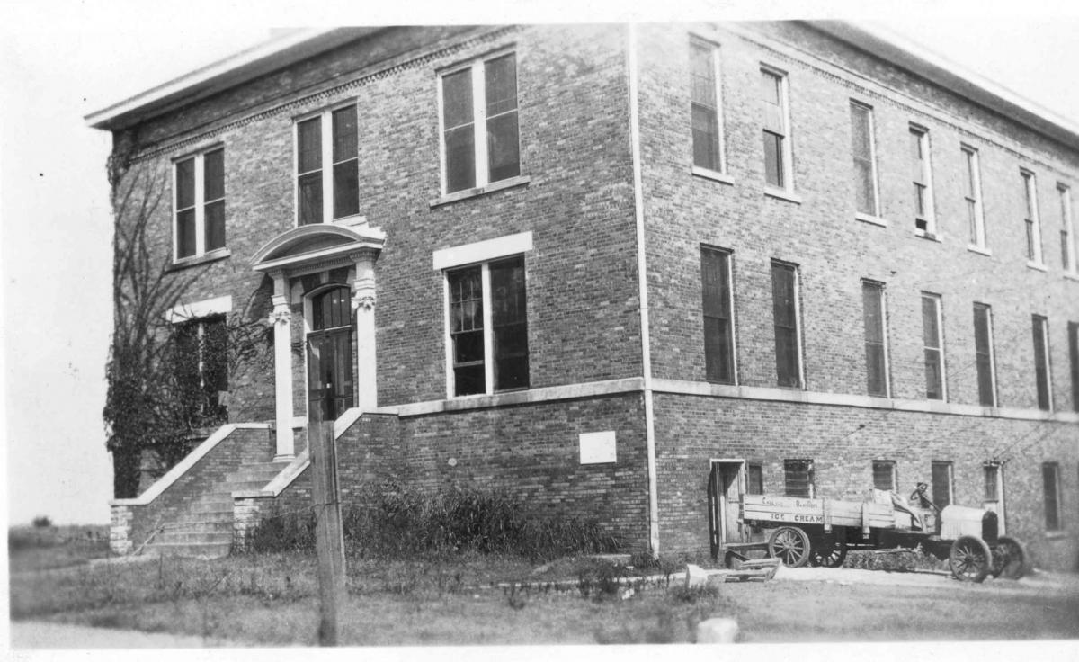 Black and white photo of Middleton Hall with old truck parked next to it