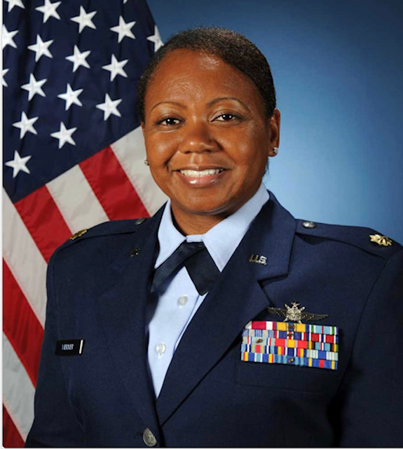 Maj Kanesha Webber in front of the American Flag