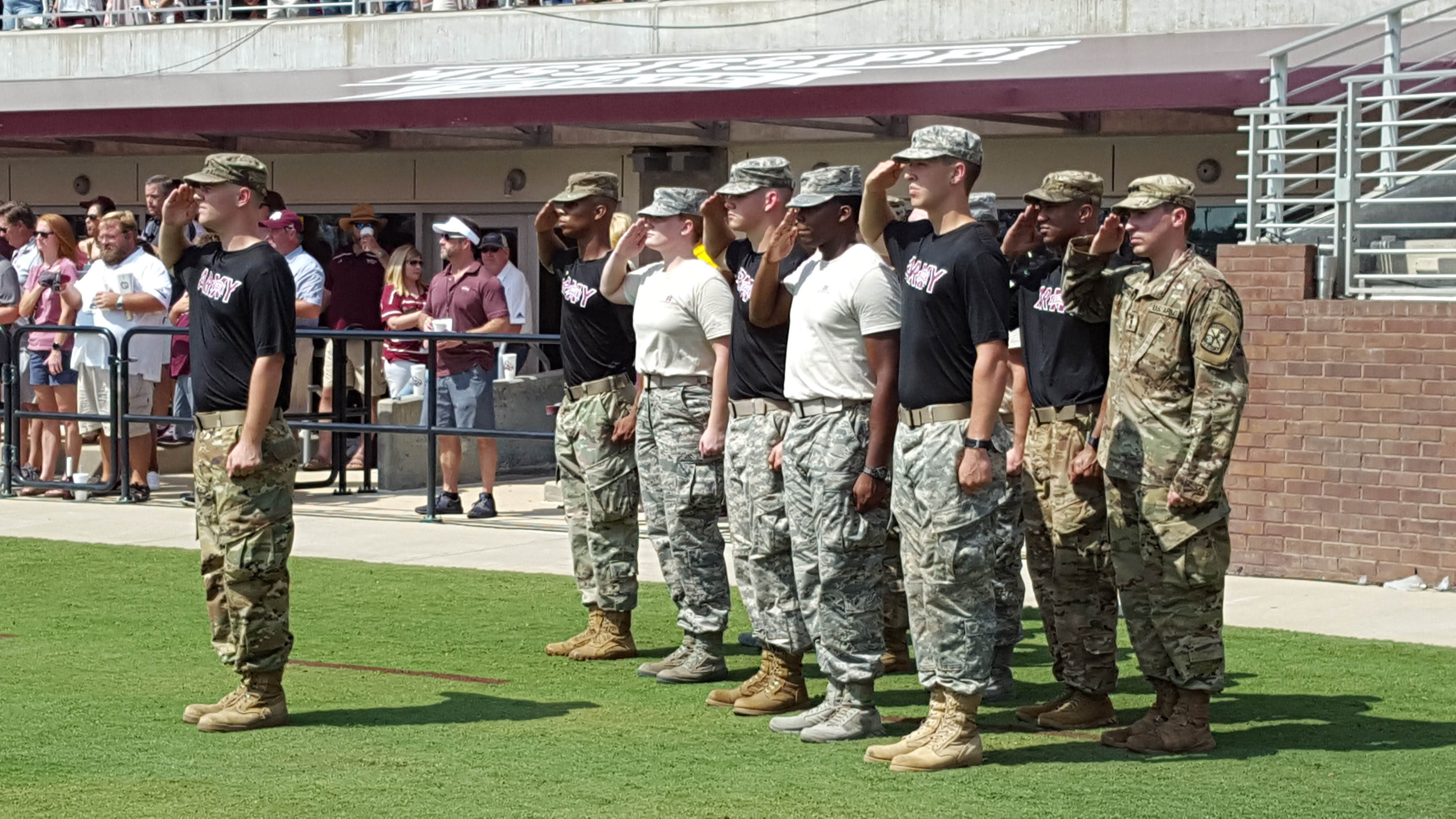 Army and Air Force cadets saluting