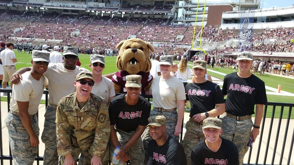 Army and Air Force cadets pose with Bully