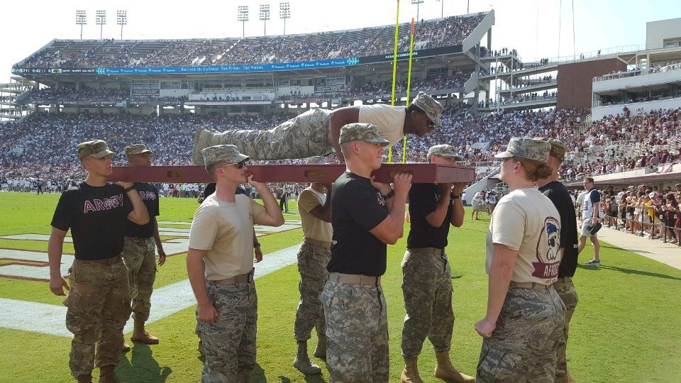 Air Force cadet performs push-ups after MSU scores